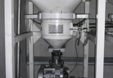 Distribuidor alveolar de transport pneumàtic a la sortida d'un buidatge de big-bag