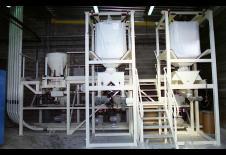 Procés de buidatge de big-bag amb dosificació i transport pneumàtic